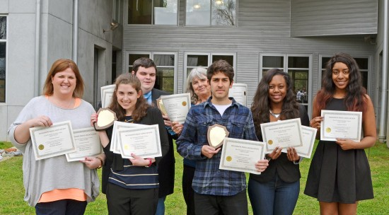 Delta State journalism students Laura Orsborn (left to right), Elisabetta Zengaro, Conor Bell (back row), Tiago Doneux, Aallyah Wright and La Tia Penn display a record number of Mississippi Press Association awards for news, editorials, features, photography, graphic design and general excellence. The awards were presented at the annual Better Newspaper Contest in Jackson on March 26. Associate professor Patricia Roberts, Delta Statement advisor, is fourth from left. (The Delta Statement)
