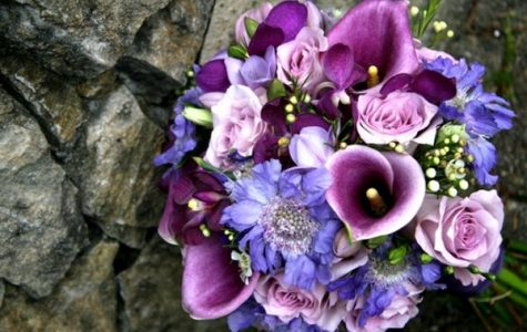 Purple and white calla lilies which symbolize charm and innocence respectively.