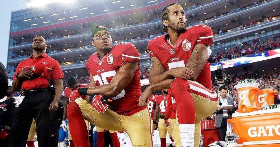 Colin Kaepernick Taking a Knee with Team Mate