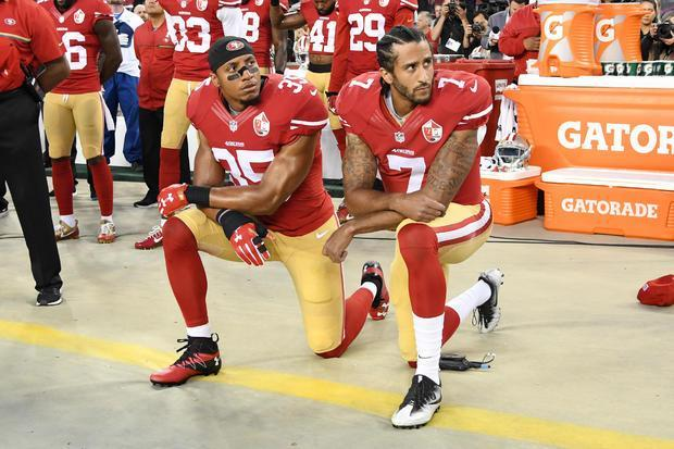 Colin+Kaepernick+and+Eric+Reid+kneeling+during+the+National+Anthem.+The+two+have+both+settled+with+the+NFL+on+their+collusion+lawsuit.