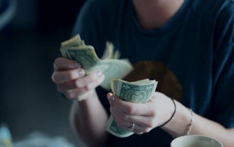 John earns money doing other students homework online.