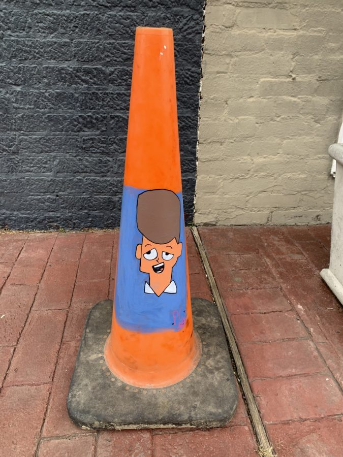 A painted traffic cone by PC, showing that not all graffiti is bad and offensive.