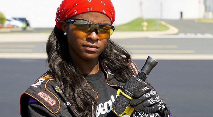 Brehanna Daniels, NASCAR's first female tire-changer. Photo Credit: Fox4